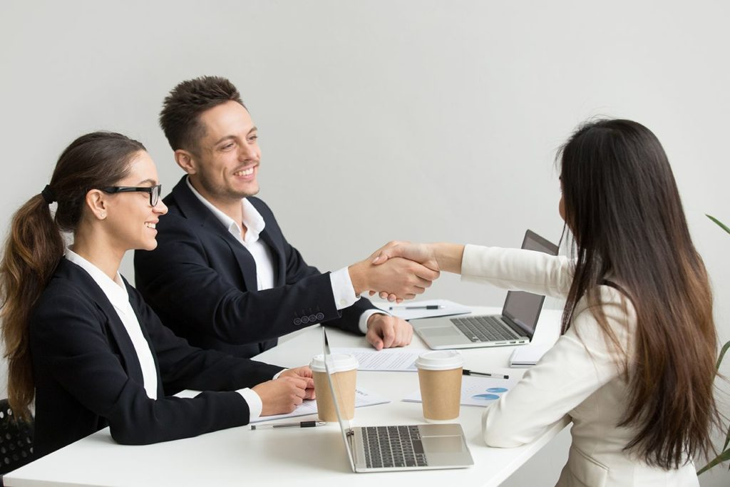 friendly-partners-handshaking-group-meeting-thanking-successful-teamwork1