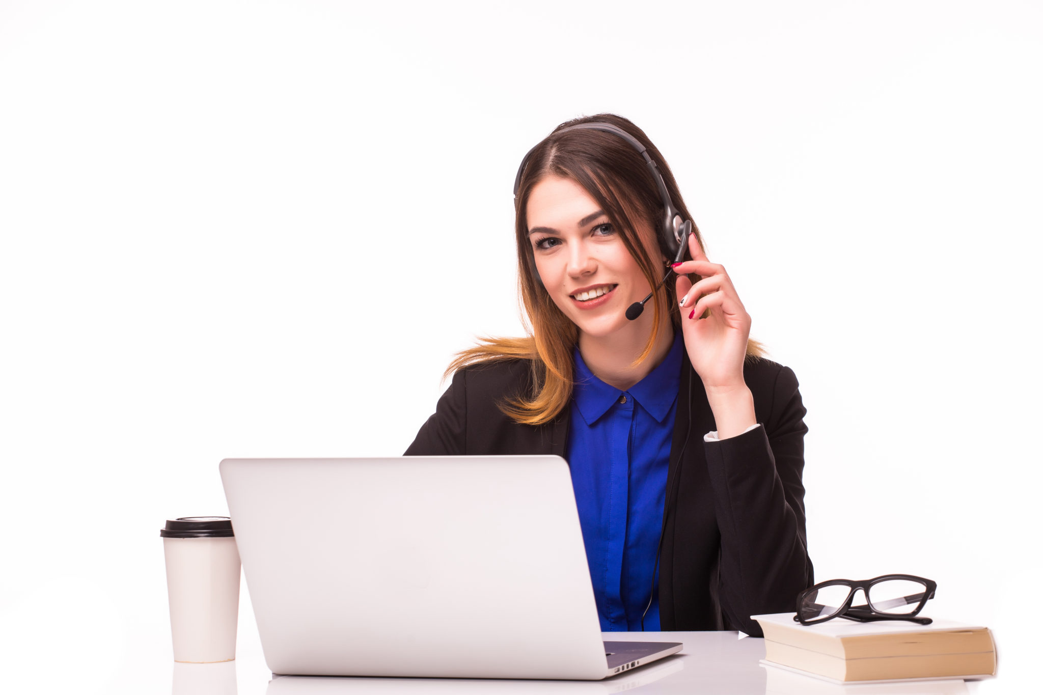 Portrait of smiling cheerful beautiful young support phone operator in headset with laptop, isolated over white background